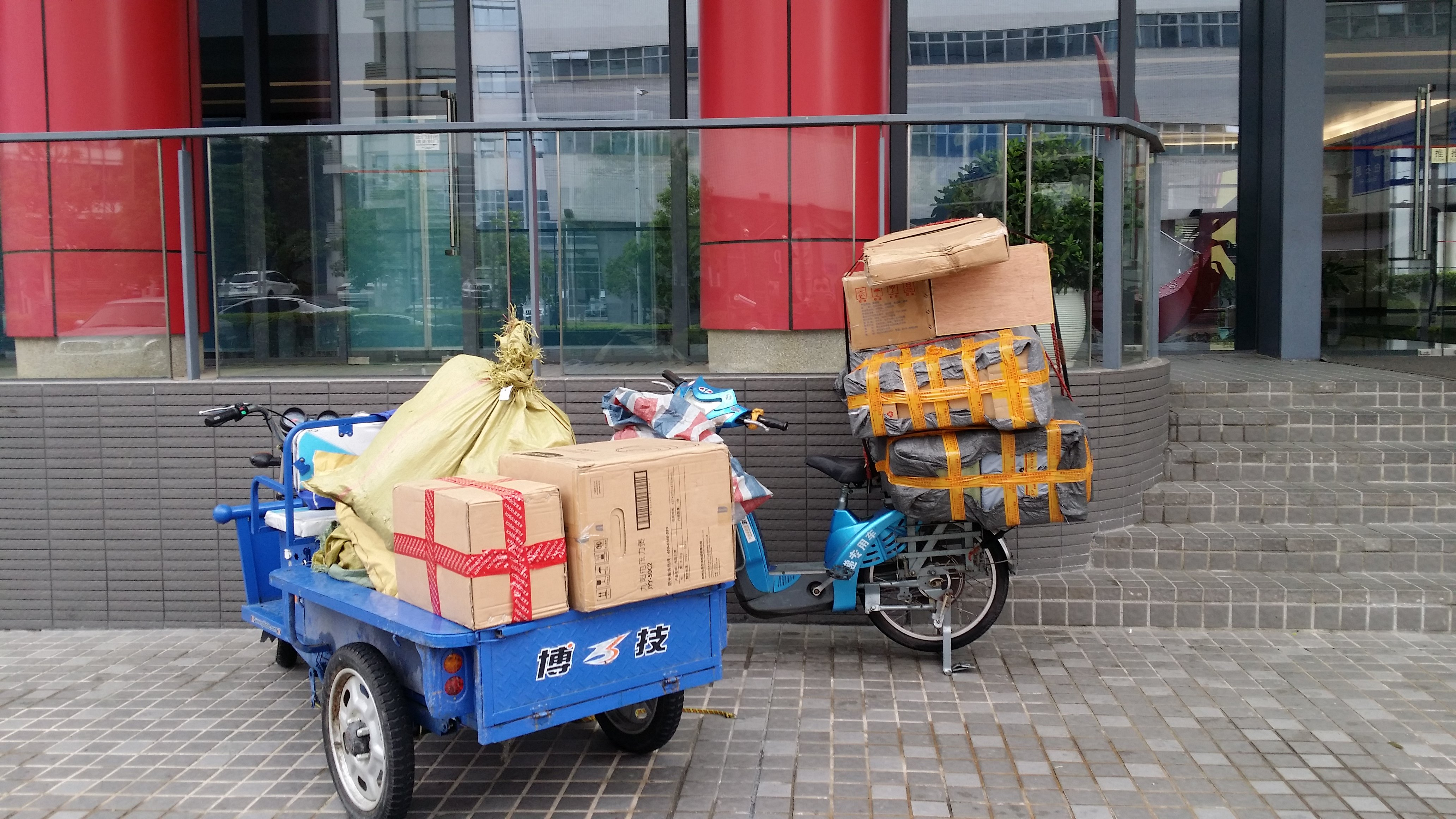 Parcels arriving by electric scooter/ truck at Hong Kong University, Shenzhen campus.