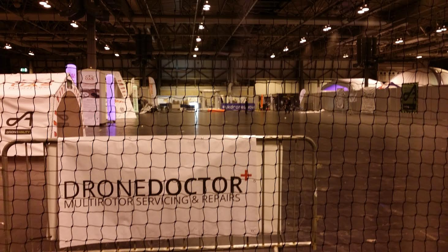 Drone Doctor banner in the main flying arena at the UK Drone Show 2015 NEC Birmingham